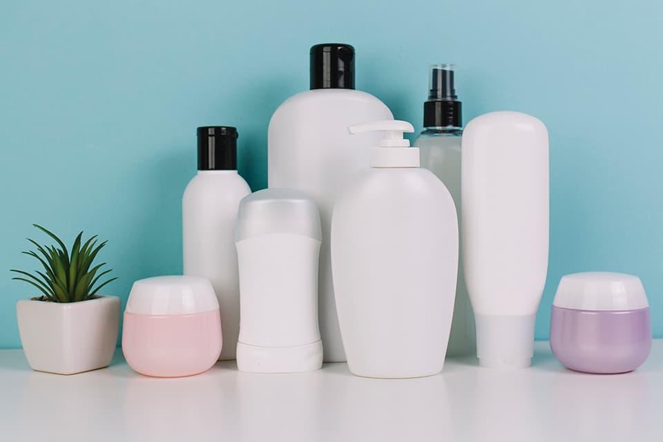 Small-plant-near-various-cosmetics-bottles
