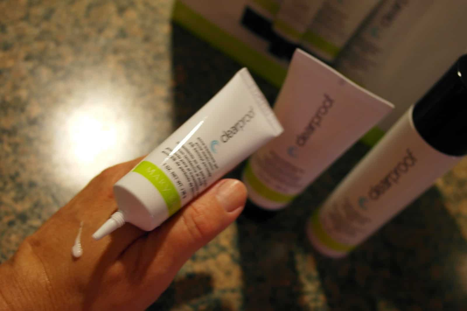 applying make acne treatment from Mary Kay