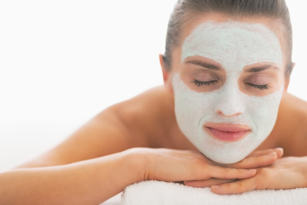 Woman with clay facial mask on